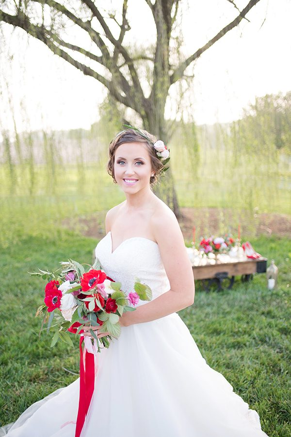 red wedding bouquets - photo by Elizabeth Moore Photography http://ruffledblog.com/come-fly-away-with-me-wedding-inspiration