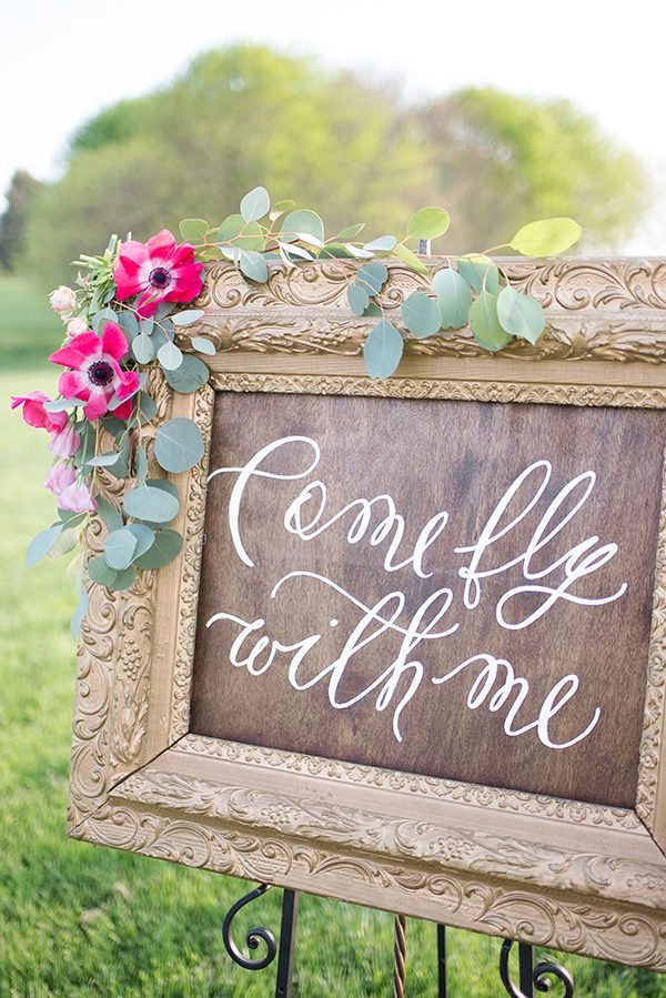 rustic wedding signs - photo by Elizabeth Moore Photography http://ruffledblog.com/come-fly-away-with-me-wedding-inspiration