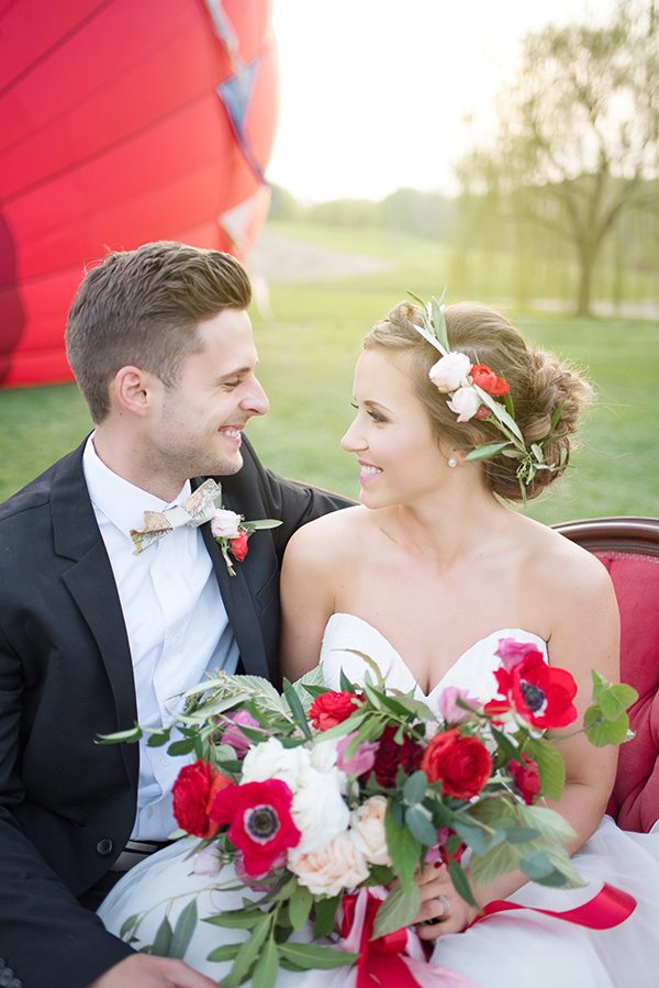 red wedding colors - photo by Elizabeth Moore Photography http://ruffledblog.com/come-fly-away-with-me-wedding-inspiration