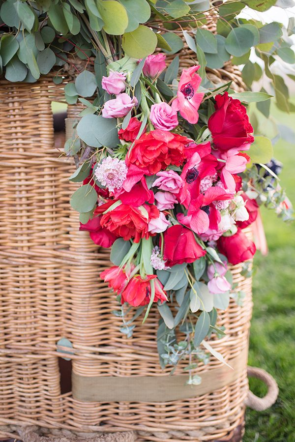 pink and red wedding flowers - photo by Elizabeth Moore Photography http://ruffledblog.com/come-fly-away-with-me-wedding-inspiration