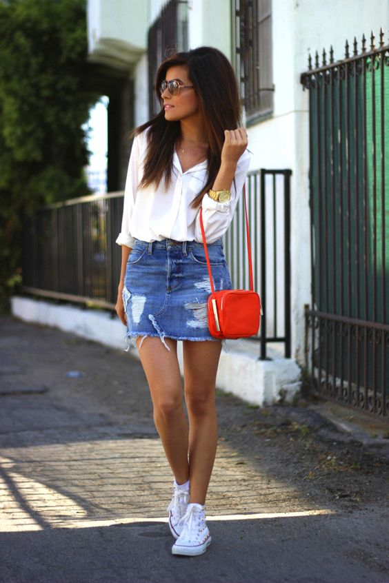 distressed denim mini, a white shirt and sneakers