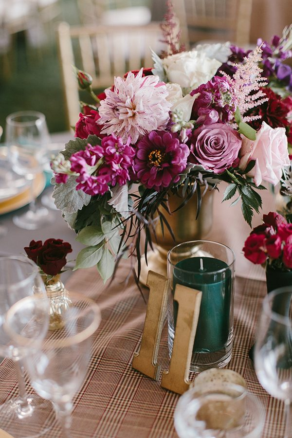plum wedding colors - photo by Emily Delamater Photography http://ruffledblog.com/maine-wedding-with-an-emerald-green-gown
