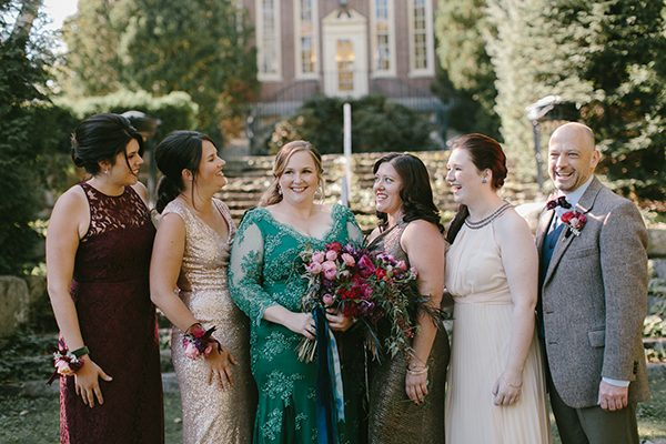 mismatched wedding party - photo by Emily Delamater Photography http://ruffledblog.com/maine-wedding-with-an-emerald-green-gown