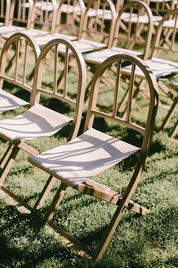 wedding chairs - photo by Emily Delamater Photography http://ruffledblog.com/maine-wedding-with-an-emerald-green-gown