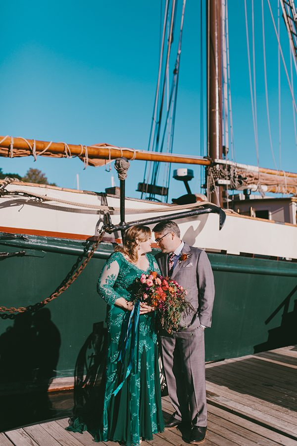 emerald green wedding gowns - photo by Emily Delamater Photography http://ruffledblog.com/maine-wedding-with-an-emerald-green-gown