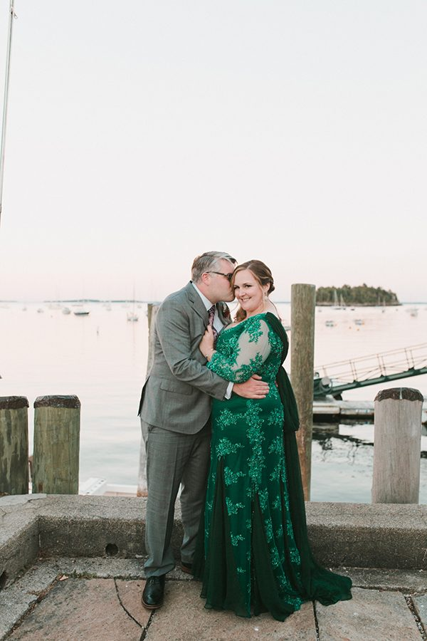 dark green wedding gowns - photo by Emily Delamater Photography http://ruffledblog.com/maine-wedding-with-an-emerald-green-gown