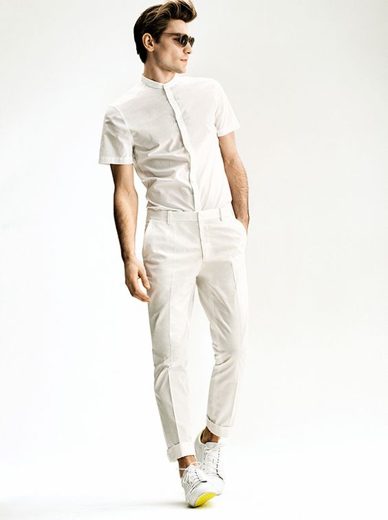 a white short sleeved shirt and trousers with sneakers