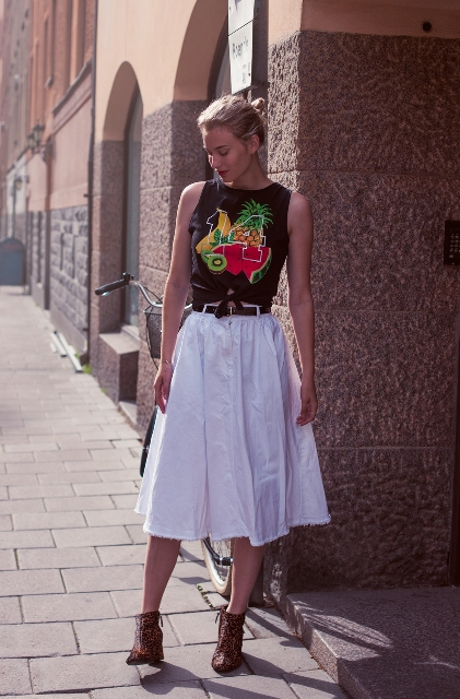 Look with fruit print t shirt and white skirt