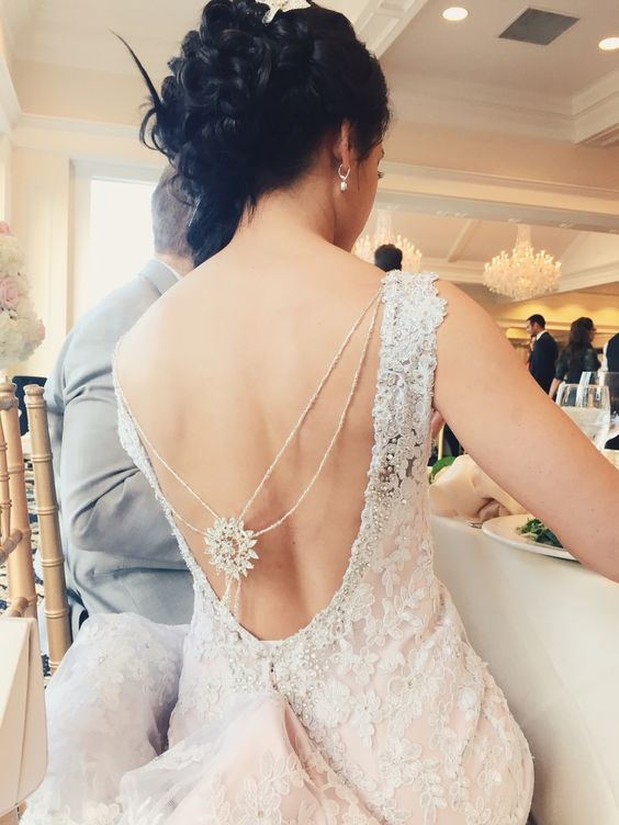 statement back necklace attached to the dress