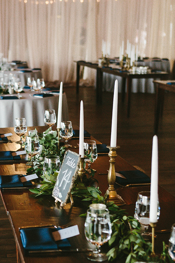 navy and gold tables - photo by W&E Photographie http://ruffledblog.com/modern-industrial-atlanta-wedding