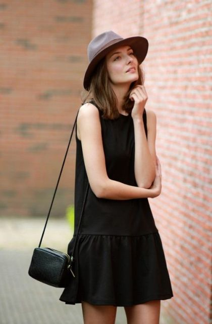 Look with black drop waist dress, mini bag and hat