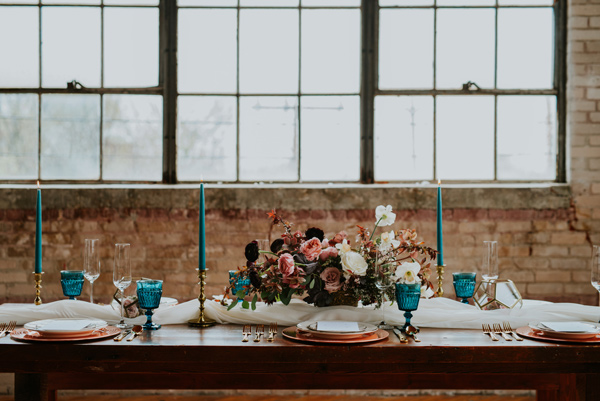teal wedding details - photo by Kate Touzel Photography http://ruffledblog.com/modern-metallic-wedding-inspiration