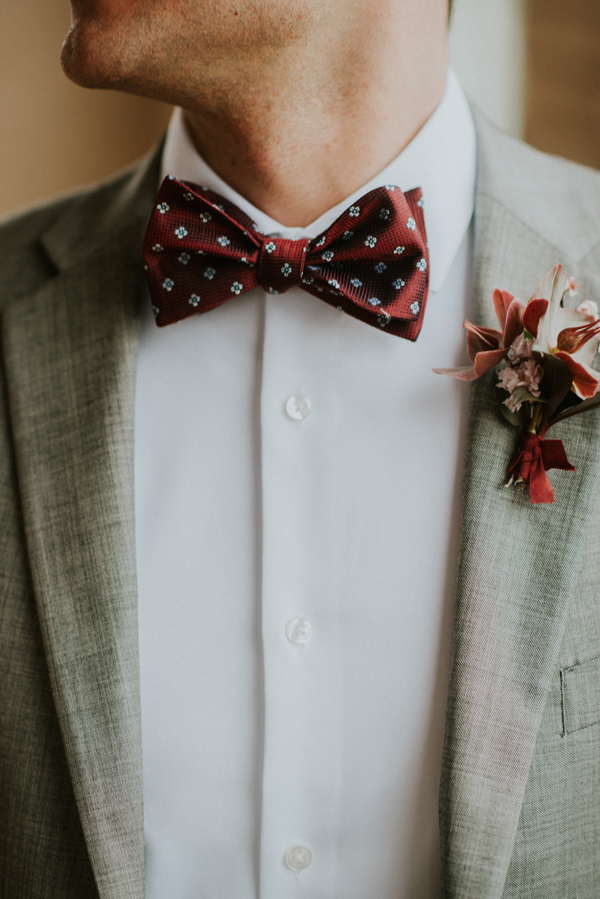 bowtie ideas - photo by Kate Touzel Photography http://ruffledblog.com/modern-metallic-wedding-inspiration