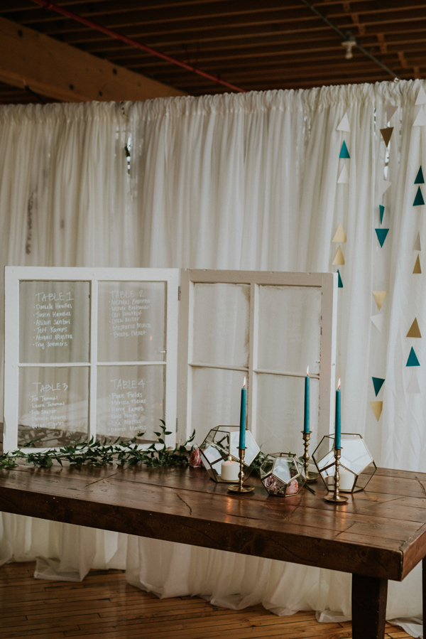wedding table seating charts - photo by Kate Touzel Photography http://ruffledblog.com/modern-metallic-wedding-inspiration