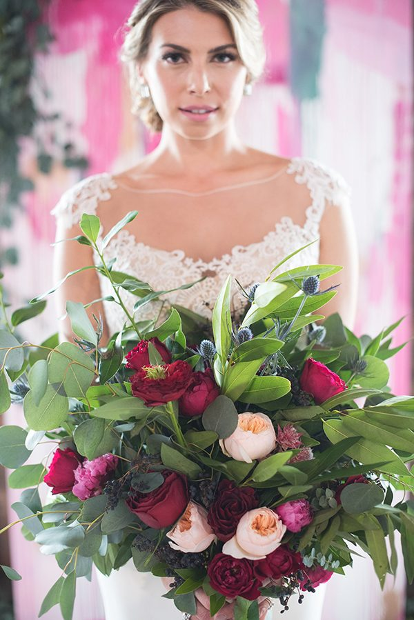 pink and red bouquets - photo by Marisa Belle Photography http://ruffledblog.com/fuchsia-industrial-wedding-inspiration