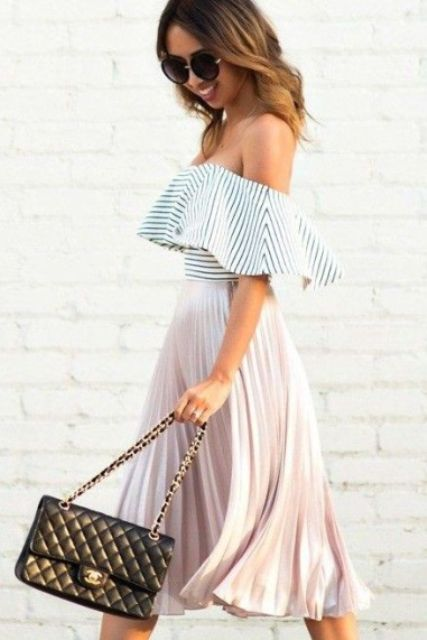 Girlish outfit with off the shoulder ruffle top and pleated skirt