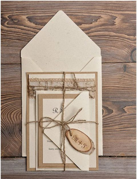 Wedding invitation with wood charm