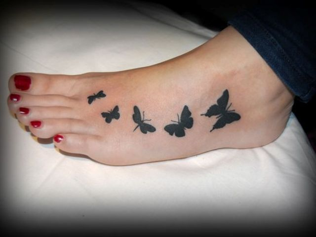 butterfly tattoo on a foot