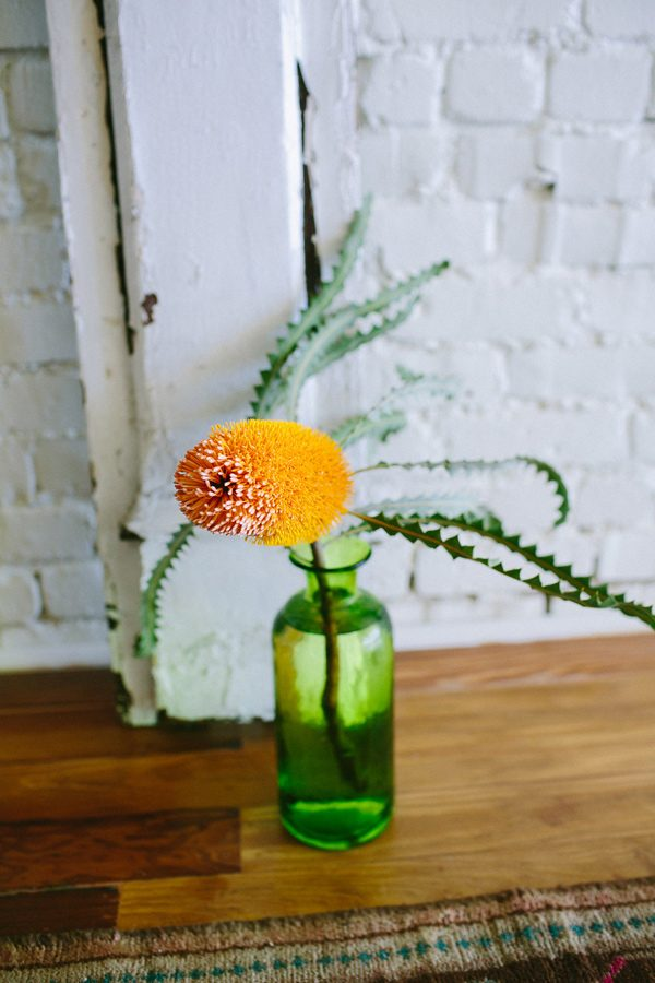 orange wedding flowers - photo by Amber Vickery Photography http://ruffledblog.com/tropical-cuban-wedding-inspiration