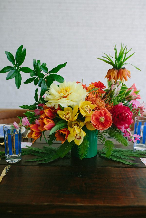 colorful wedding centerpieces - photo by Amber Vickery Photography http://ruffledblog.com/tropical-cuban-wedding-inspiration