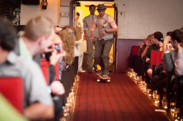 Groom with skateboard on the wedding ceremony