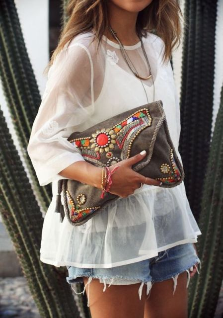 Boho chic look with loose white sheer shirt and shorts