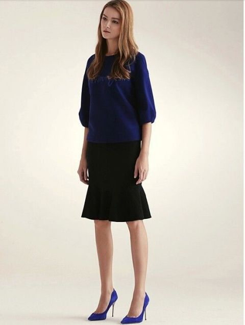 Look with blue shirt and black trumpet skirt