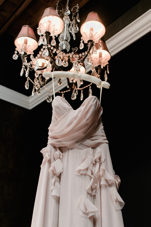Blush dress hanging from chandelier | Bonphotage photography