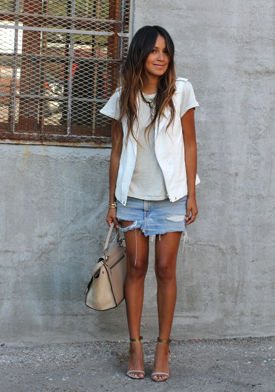 distressed denim mini with a neutral top and a white blazer
