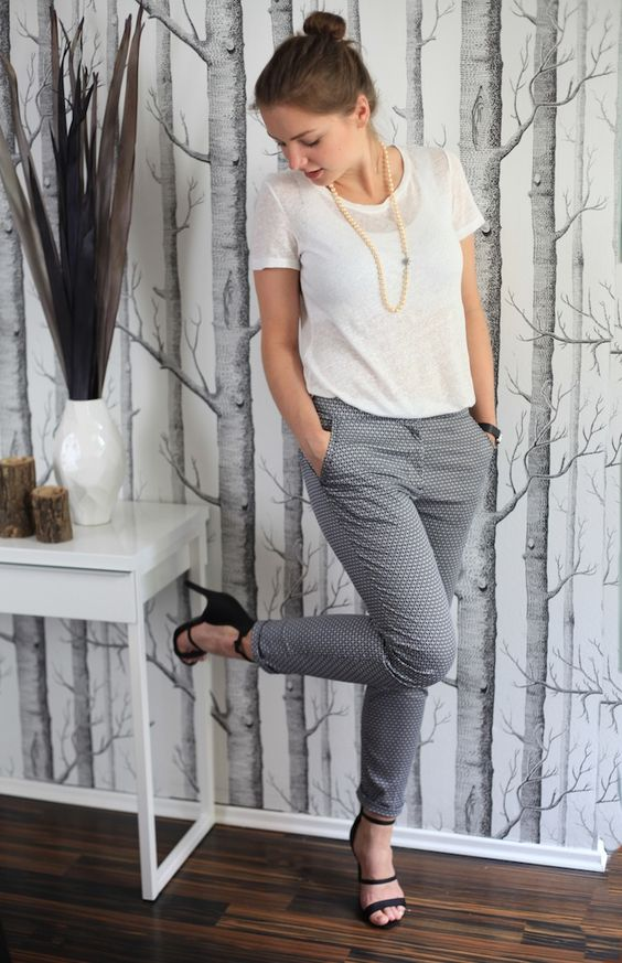 white top and grey patterned pants with black heels