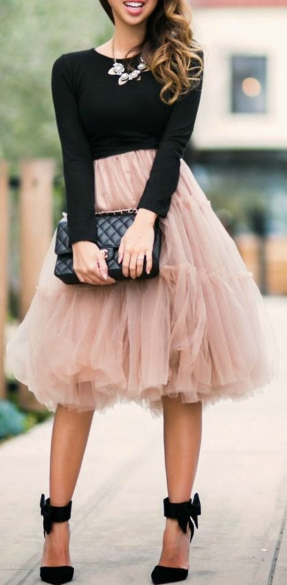 dusty pink tutu skirt, a black shirt and black shoes