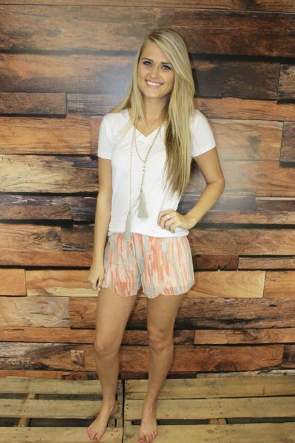 Watercolor shorts with white classic t-shirt and tassel necklace