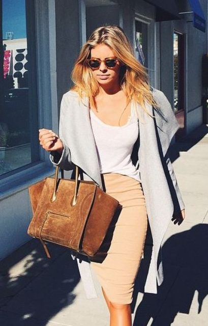 a tan skirt, a white top, a summer coat and a tan leather bag