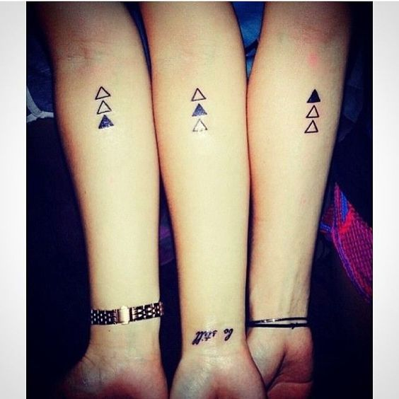 creative tirangle arm tattoos for 3 persons