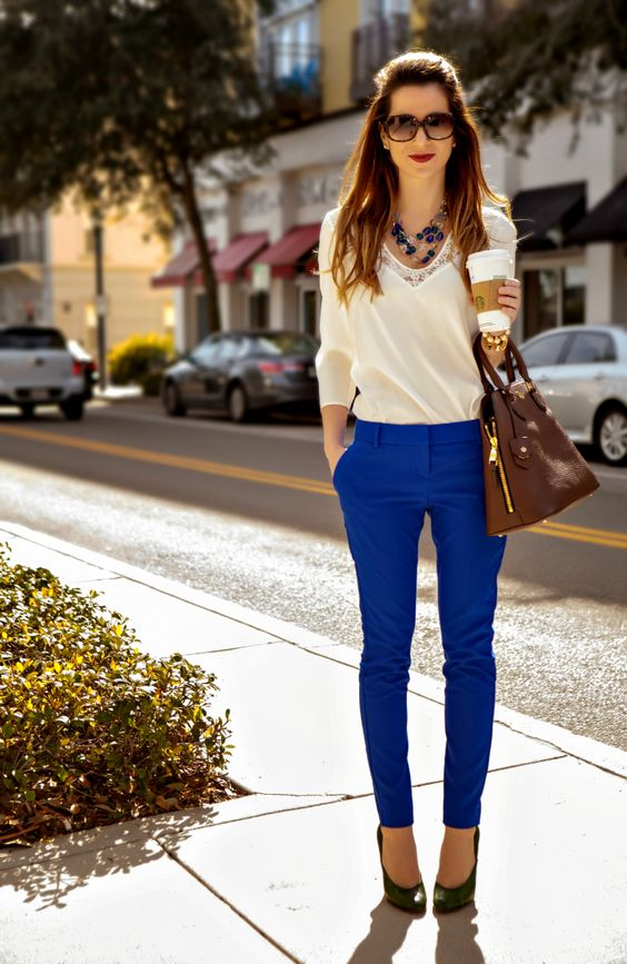 ivory lace blouse and royal blue trousers with green shoes