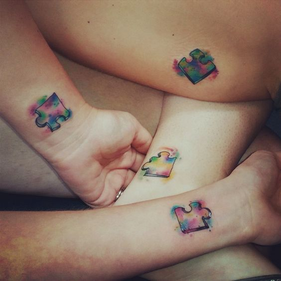 colorful puzzle tattoos for a bunch of friends