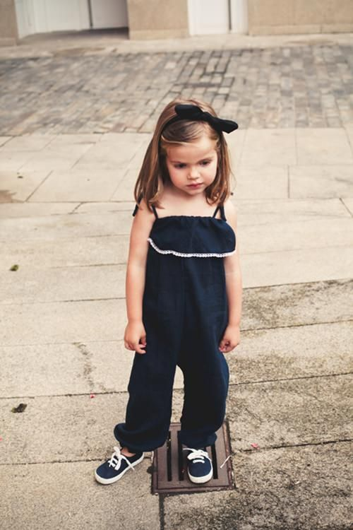 navy ruffled sunsuit with navy sneakers