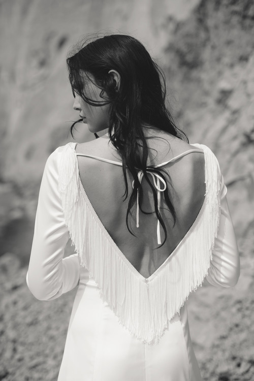Boho open back dress with a fringe back is cool for a free spirited bride