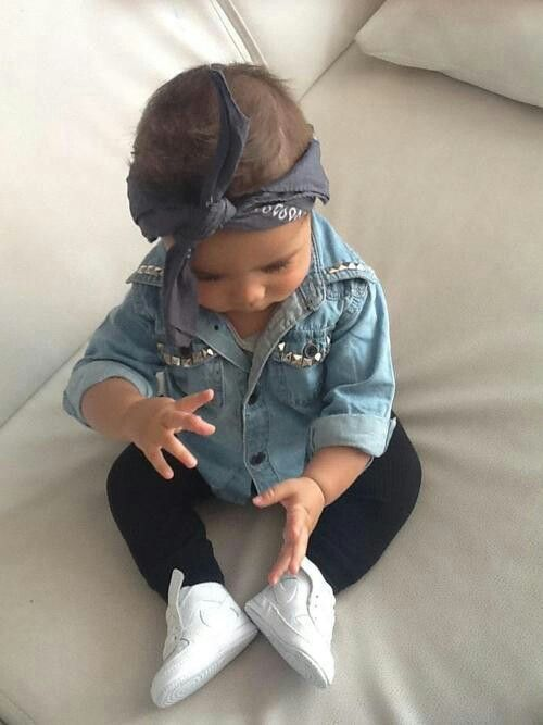 black pants, a denim shirt and white sneakers