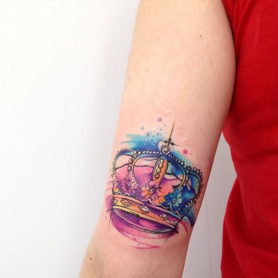 watercolor arm crown tattoo