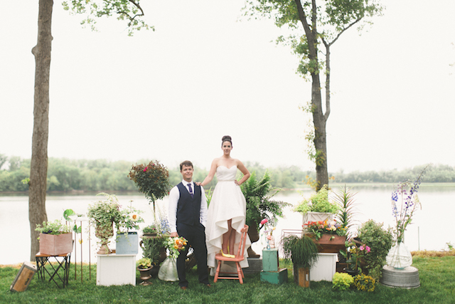 Potted plants at various heights for a wedding ceremony backdrop | Stephanie Yonce Photography