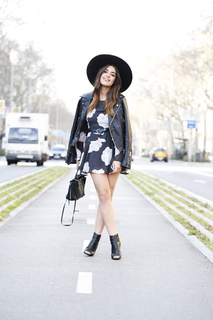Trendy look with skater dress, boots and leather jacket