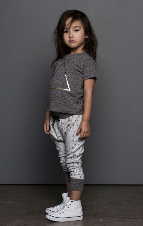 sport printed pants, a grey tee and white sneakers