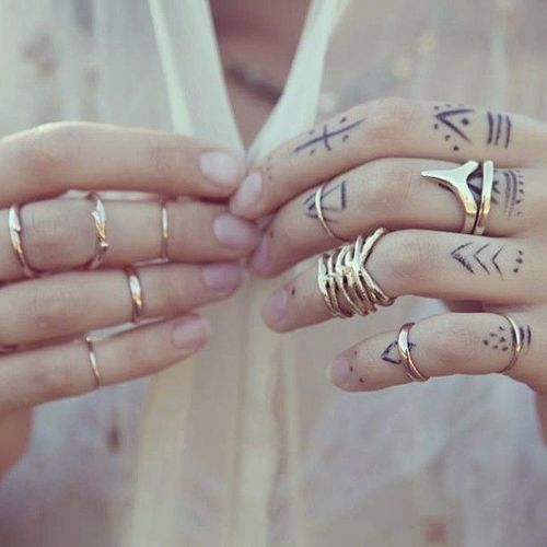 simple black tattoos on all fingers