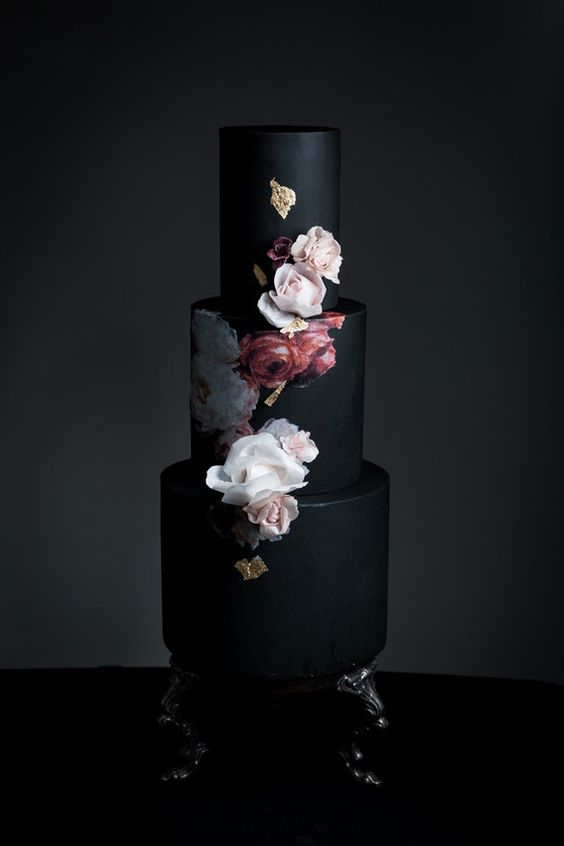 black wedding cake with painted and natural flowers