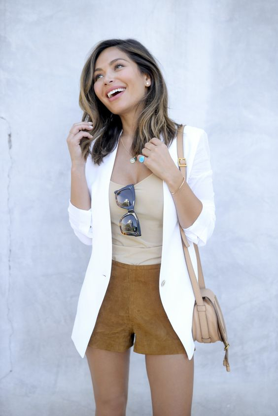 yellow shorts, a nude top, a white jacket and a nude bag