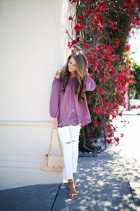 white jeans, a purple off the shoulder blouse and blush heels