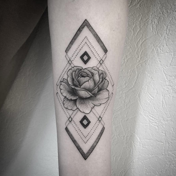 geometirc pattern and a rose on an arm