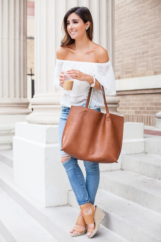ripped jeans, a white off the shoulder blouse and tan wedges