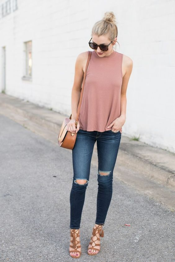 ripped jeans, a pink top, tan heels